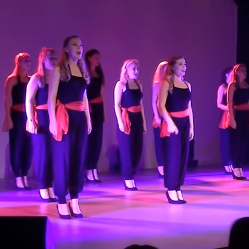 Students performing a vocal medley at Move-IT 2016 (London Excel) - Showcase Theatre